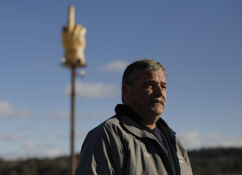 Ted Pelkey paid a sculptor $3,000 to create the single-finger salute from a 7-foot-tall chunk of pine. Then Pelkey put it on a pole.