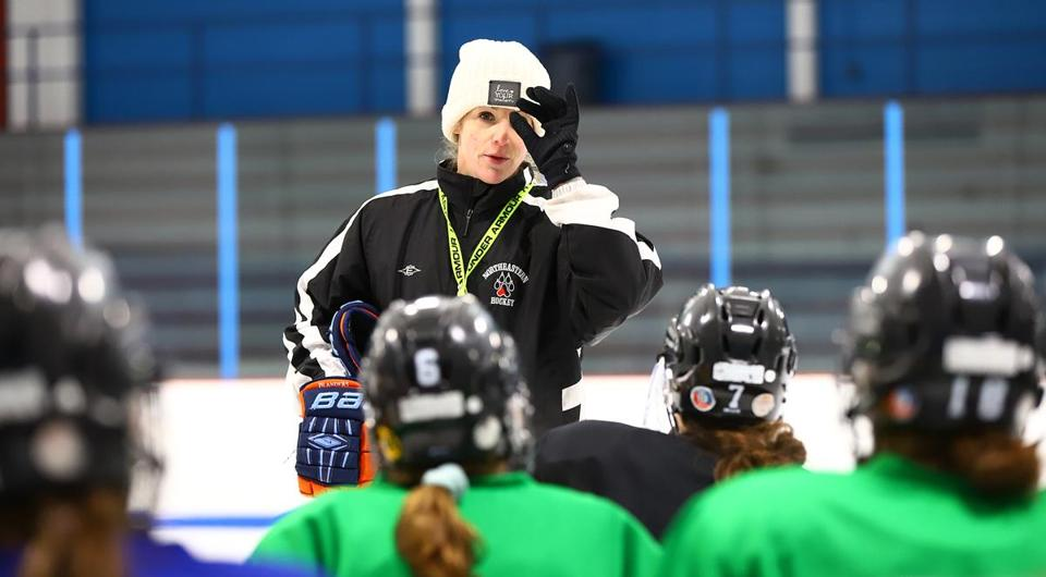 Austin Prep coach Stephanie Wood speaks to her players during morning practice at Stoneham Arena.