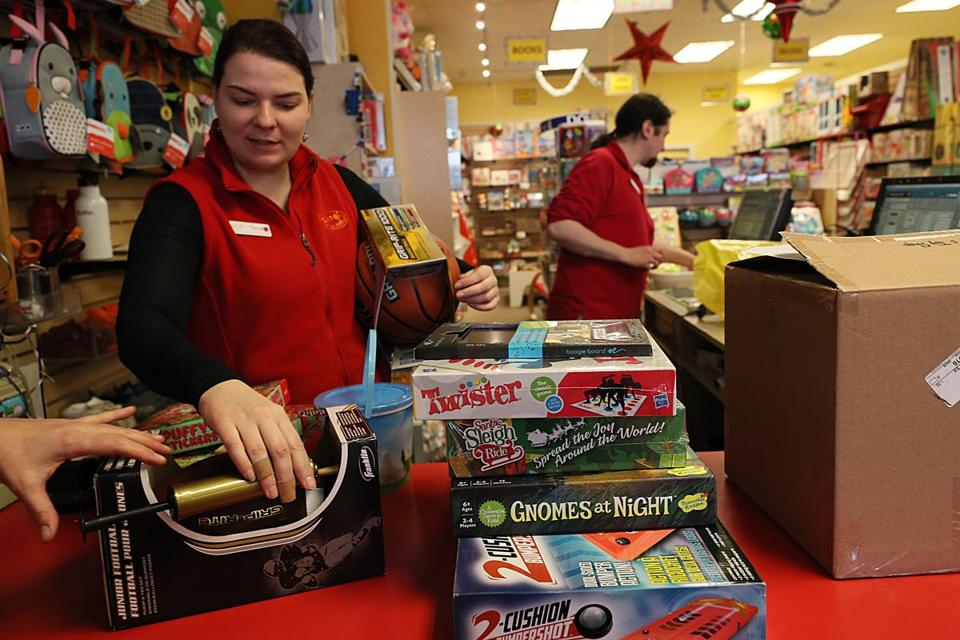 "Jamaica Plain, MA., 12/12/2018, At the Boing toy store, employees, Deva Jasheway , cq, on left, prepare to wrap and shif gifts. Amid the downfall of Toys ""R"" Us and the mindbending growth of Amazon, the toy retail scene is morphing before our very eyes. The local toy shop Boing in JP is offering home delivery and curbside pickup to compete with Amazon. Suzanne Kreiter/Globe staff"