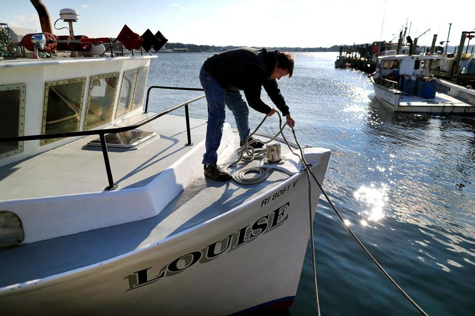 Newport, R.I. 12/12/18 Fisherman Ted Platz tightens the bow lines on his boat, Louise, docked at the Long Wharf fish pier in Newport Harbor. He said that offshore wind turbines planned to be developed where he fishes, will put a strain on the industry. Photo by John Tlumacki/Globe Staff(metro)