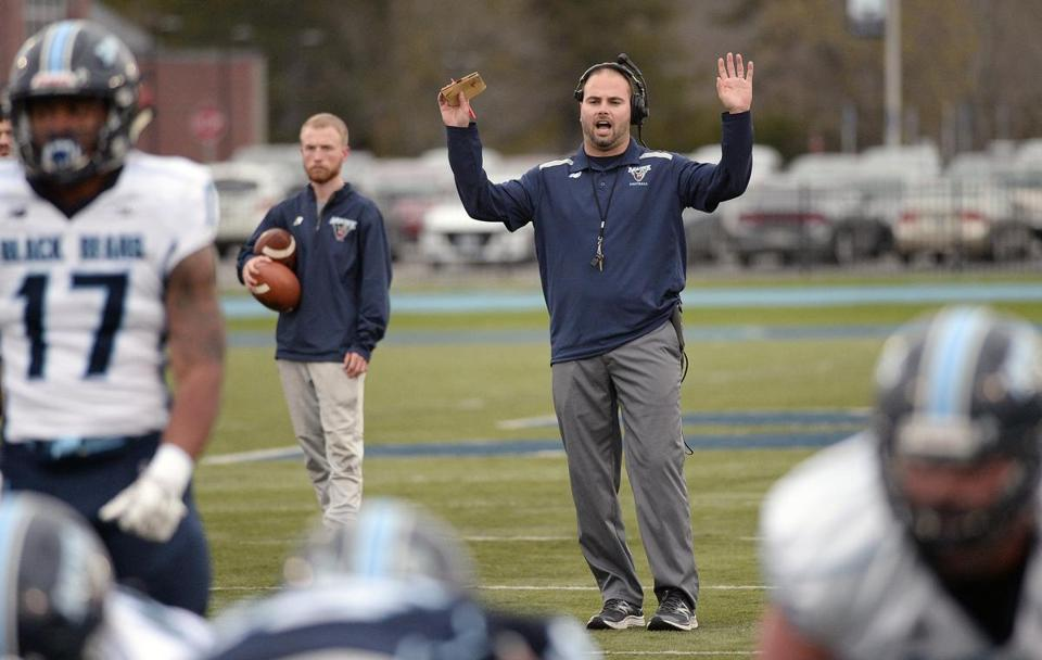 ORONO, ME - MAY 4: Head football coach Joe Harasymiak speaks to his players during the Maine spring football scrimmage at Orono Friday, May 4, 2018. (Shawn Patrick Ouellette/Portland Press Herald)