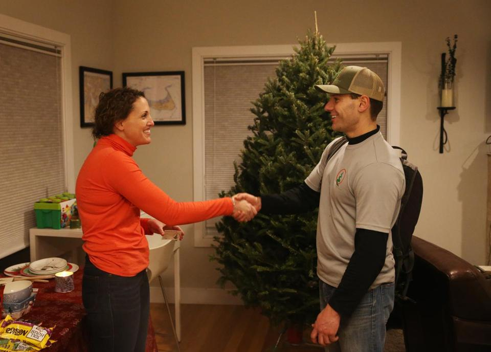 Feccia and Katelyn Ariagmo shook hands after Feccia made a tree delivery.