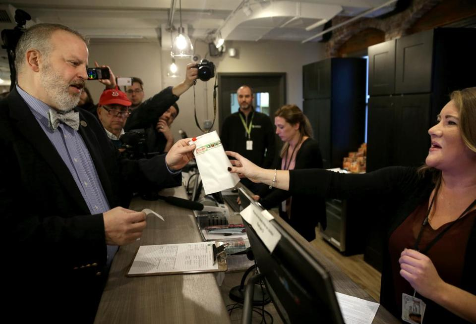 Salem MA: 12-15-2018: Salem City Councilor Josh Turiel (cq) made the first ceremonial purchase, at the ATG Marijuana dispensary in Salem.Photo/Jonathan Wiggs Boston Globe staff