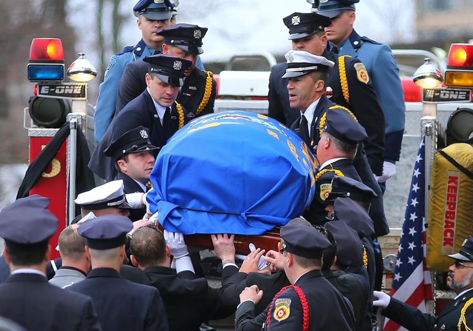 Worcester firefighters lifted the casket of Firefighter Christopher Roy.