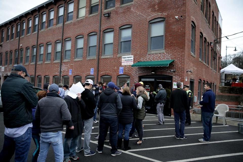 Salem MA: 12-15-2018: Customers line up to make purchases of recreational Marijuana products, at the ATG Marijuana dispensary in Salem.Photo/Jonathan Wiggs Boston Globe staff
