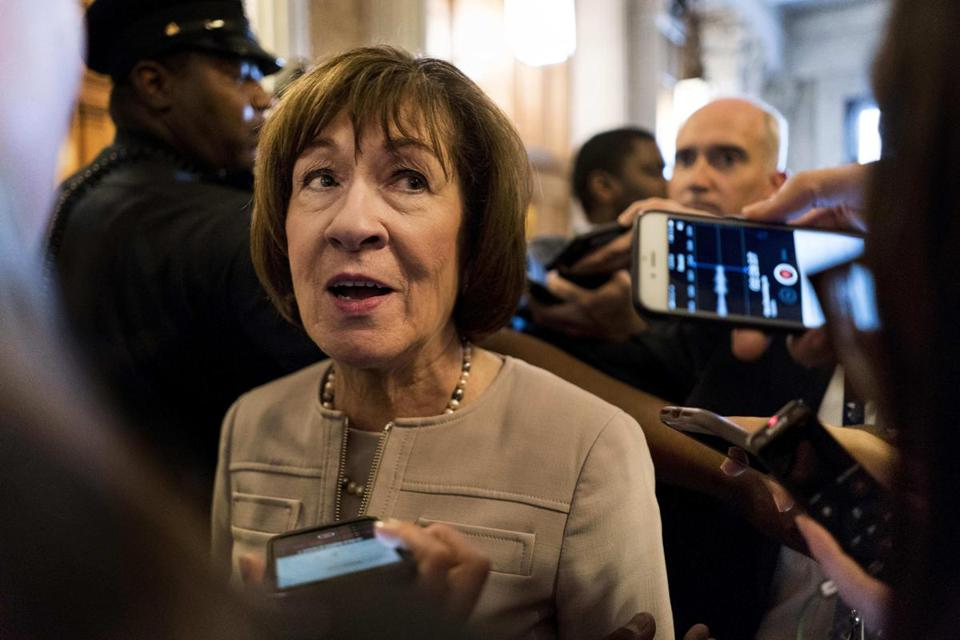Sen. Susan Collins, R-Maine, talks to a crowd a journalists after speaking on the Senate floor in favor of Brett Kavanaugh on Friday, Oct. 5. MUST CREDIT: Washington Post photo by Melina Mara