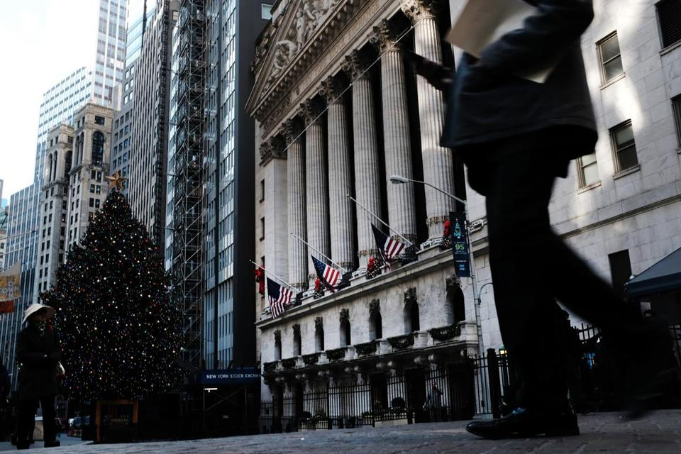 NEW YORK, NEW YORK - DECEMBER 17: People walk by the New York Stock Exchange (NYSE) and the NYSE Christmas Tree on December 17, 2018 in New York City. Stocks fell again in morning trading as investors remain jittery over trade with China, interest rates and the threat of a global slowdown. (Photo by Spencer Platt/Getty Images)