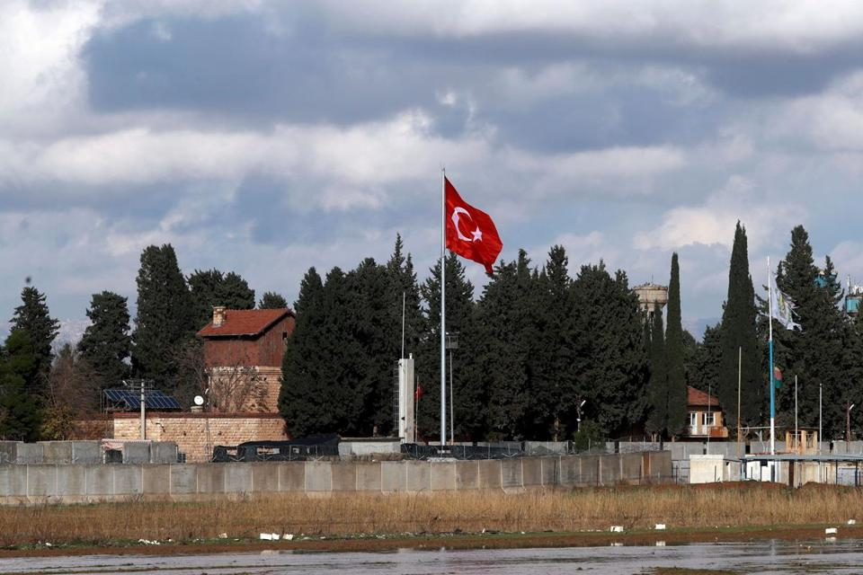 A picture taken from the Syrian town of Darbasiyah, on December 13, 2018, shows the border wall separating Turkey from Syria. - Turkey will launch a new operation in Syria within days against a US-backed Kurdish militia that Ankara considers a terrorist group, Turkish President Recep Tayyip Erdogan said on December 12. (Photo by Delil SOULEIMAN / AFP)DELIL SOULEIMAN/AFP/Getty Images