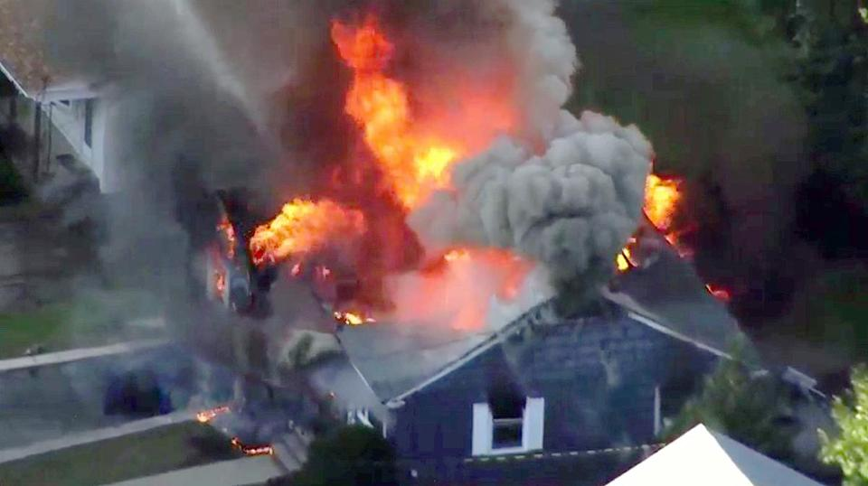FILE-- In this Sept. 13, 2018 file image taken from video provided by WCVB in Boston, flames consume a home of Lawrence, Mass. police officer Ivan Soto in Lawrence, Mass, a suburb of Boston. Officials announced that most have been connected back to their service following the fires, explosions and loss of their main heating utility, but there are many issues which still need to be solved. (WCVB via AP)