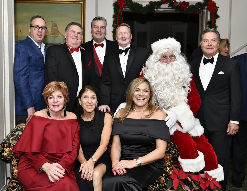 *** For publication after 12/17 -jr*** SALEM, 12/15/2018 - The Salem Snowboard Foundation Board, back row, from left, Pat Buonopane, Chris McNeil, David Silvey, Bill Lynch, Globe Santa and Frank Romano. Front row, from left, Sheila McNeil, Jane Fuller, and Julie Silvey, during the Salem Snowball at the Hathorne Hotel, which raised money for the Josh Reynolds for The Boston Globe (Globe Santa)