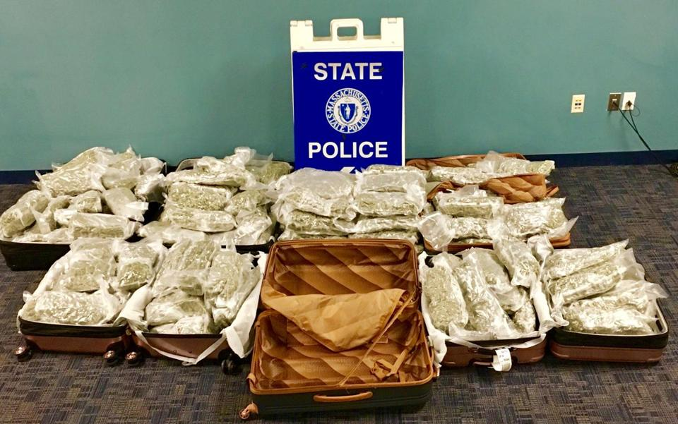 Three people were arrested for trying to smuggle more than 150 pounds of marijuana through Logan International Airport.