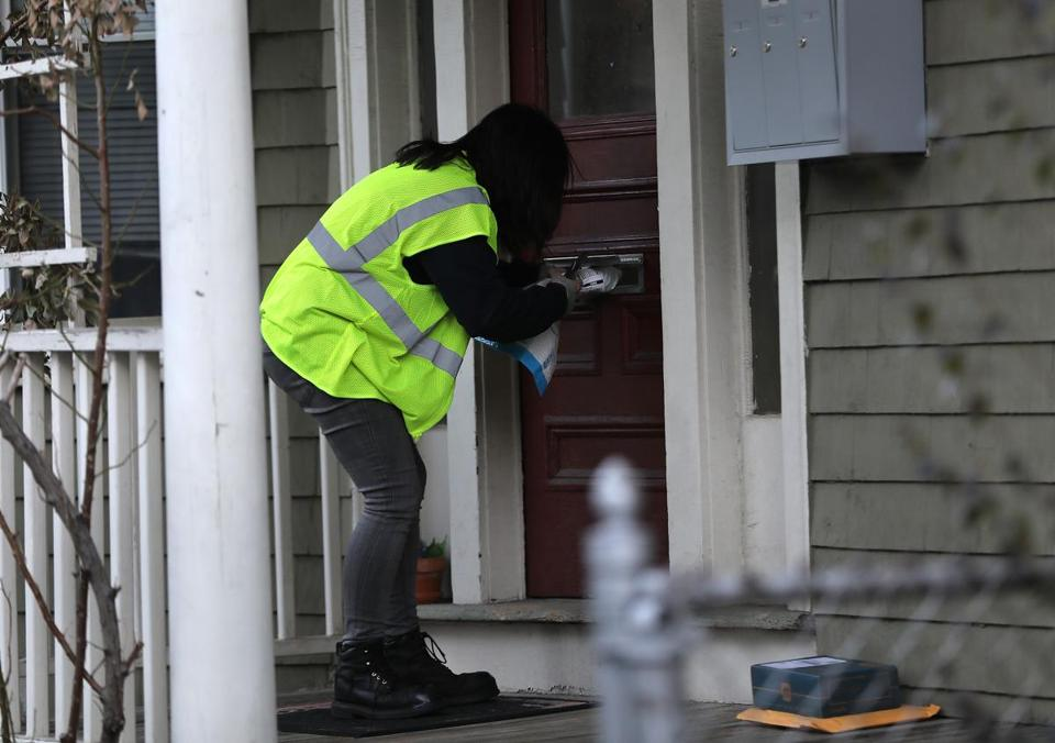 Cambridge, MA - 12/18/18 After picking up packages from the Amazon Fulfillment center in Everett, Amazon Flex driver Arielle McCain (cq), 24, delivers them in Cambridge. Photo by Pat Greenhouse/Globe Staff Topic: AmazonFlexBusiness Reporter: Janelle Nanos