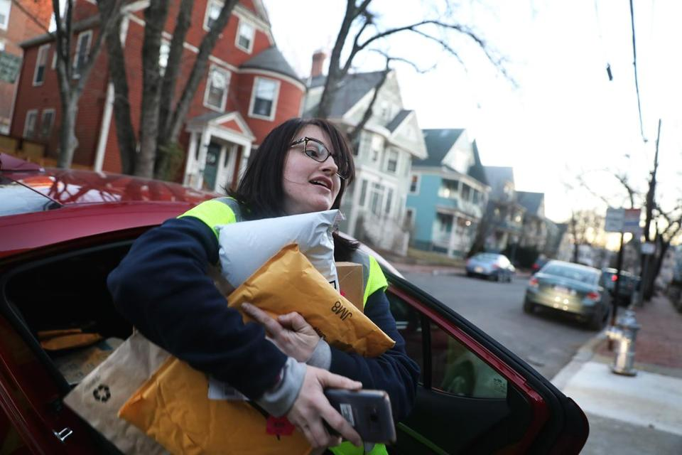 Arielle McCain worked off an Amazon app, picking up packages in Everett and then delivering them in Cambridge.