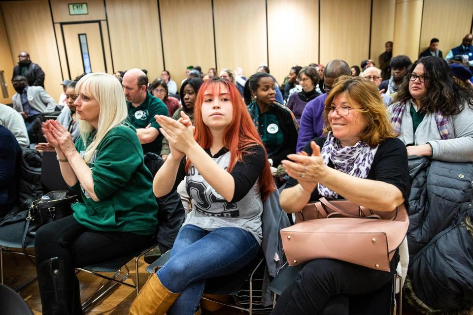 12/19/2018 ROXBURY, MA Urban Science Academy teacher Amy Eisenschmidt (cq), West Roxbury Academy junior Catari Giglio (cq) 16, and her mother Ingrid Morales (cq) applauded for no school closures during a Boston School Committee meeting held at the Bruce C. Bolling Municipal Building in Roxbury. (Aram Boghosian for The Boston Globe)