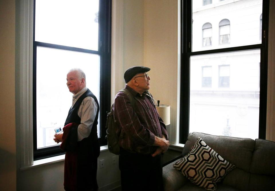 John Callaghan (left) and Brian Richard admired a studio apartment while touring The Union Saturday.