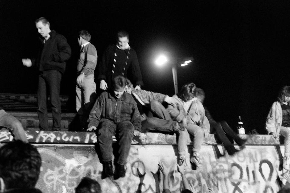 "(FILES) In this file photo taken on November 10, 1989 West-Berliner climb on the Berlin Wall to ask for its fall. - So many momentous events have happened on November 9 in Germany's 20th century that it has become known as the country's ""day of fate"". The date carries extra weight this year as it marks 100 years since the end of the monarchy as well as the 80th anniversary of the infamous ""Kristallnacht"" night of Nazi attacks against Jews. (Photo by Françoise CHAPTAL / AFP)FRANCOISE CHAPTAL/AFP/Getty Images"