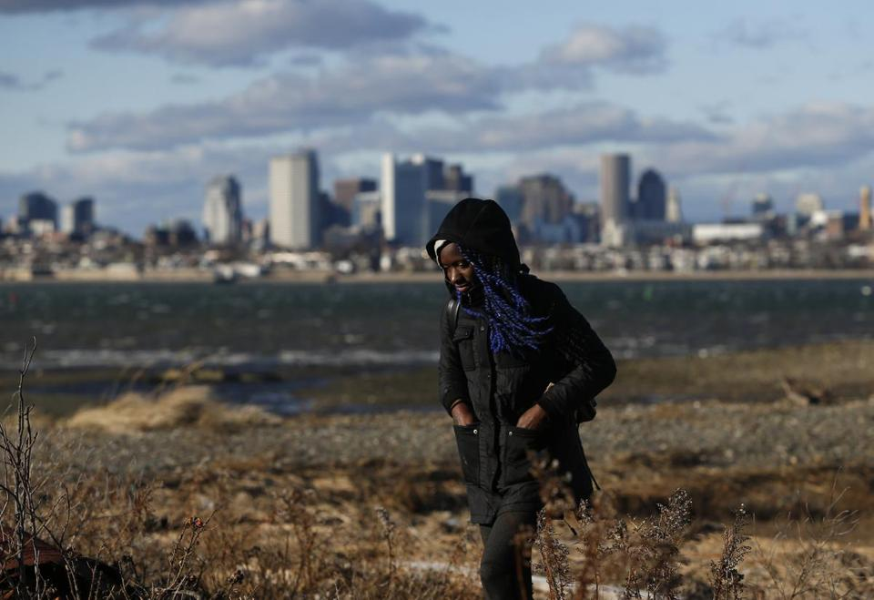 Boston, MA, 01/1/2019 -- Joye Williams, of Dorchester walked along the shoreline at Thompson Island. For 35 years the Friends of the Boston Harbor Islands have been running a New Year's Day excursion to Thompson Island. (Jessica Rinaldi/Globe Staff) Topic: 02islandtrip Reporter: