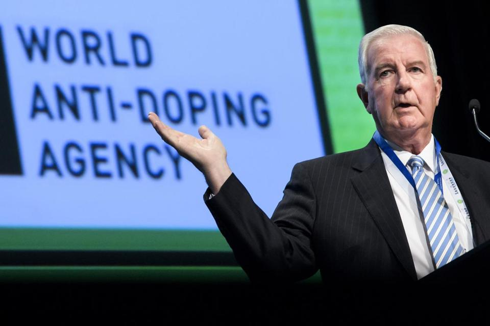 FILE - In this May 21, 2018, file photo, Craig Reedie, world anti-doping agency (WADA) President, delivers his speech during the opening day of the 2018 WADA annual symposium, at the Swiss Tech Convention Center, in Lausanne, Switzerland. (Jean-Christophe Bott/Keystone via AP, File)