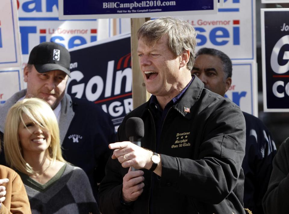 Massachusetts Republican gubernatorial candidate Charlie Baker, right, addresses an audience as former Boston Red Sox pitching ace Curt Schilling, top left, looks on with his wife Shonda, left, during a campaign stop in Haverhill, Mass., Sunday, Oct. 31, 2010. Baker will face Democrat incumbent Gov. Deval Patrick in Tuesday's general election. (AP Photo/Steven Senne) Library Tag 11012010