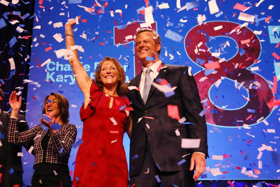 Boston, MA - November 06, 2018: Governor Charlie Baker and his wife Lauren celebrate with Lieutenant Governor Karyn Polito, left, during a Baker-Polito Campaign Election Night Rally at the Hynes Convention Center in Boston, MA on November 06, 2018. (Baker has held dominant leads of approximately 40 points or more over Gonzalez in recent public polls. But both exuded confidence in the waning days of campaigning and during what could be grueling stretches of hand-shaking, driving, and last-minute politicking.) (Craig F. Walker/Globe Staff) section: metro reporter:
