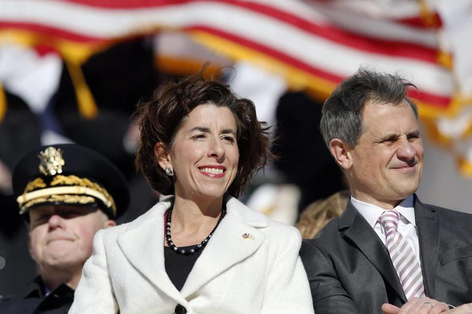 Rhode Island Gov. Gina Raimondo sits with her husband Andy during inauguration ceremonies at the State House in Providence, R.I., Tuesday, Jan. 1, 2019. (AP Photo/Michael Dwyer)
