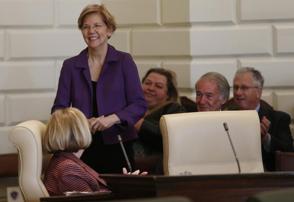 Boston, MA, 01/2/2019 -- Senator Elizabeth Warren stands to be recognized during the swearing in and the first formal session of the 191st General Court of the Commonwealth of Massachusetts. (Jessica Rinaldi/Globe Staff) Topic: 03generalcourtpic Reporter: