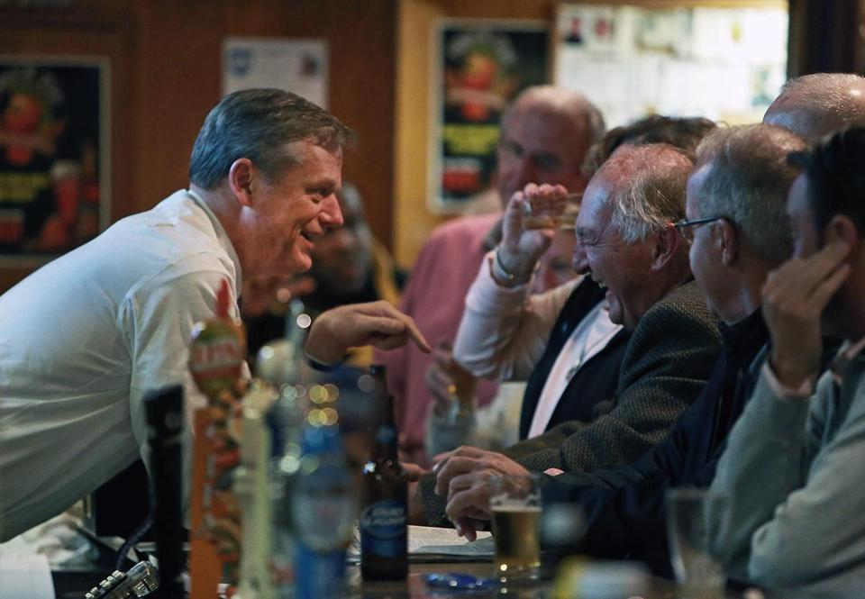 11/05/14: Dorchester, MA: Massachusetts governor-elect Charlie Baker visited the Eire Pub in Dorchester on Wednesday night. He is pictured chatting with patrons while standing behind the bar. (Globe Staff Photo/Jim Davis) section: metro topic: baker