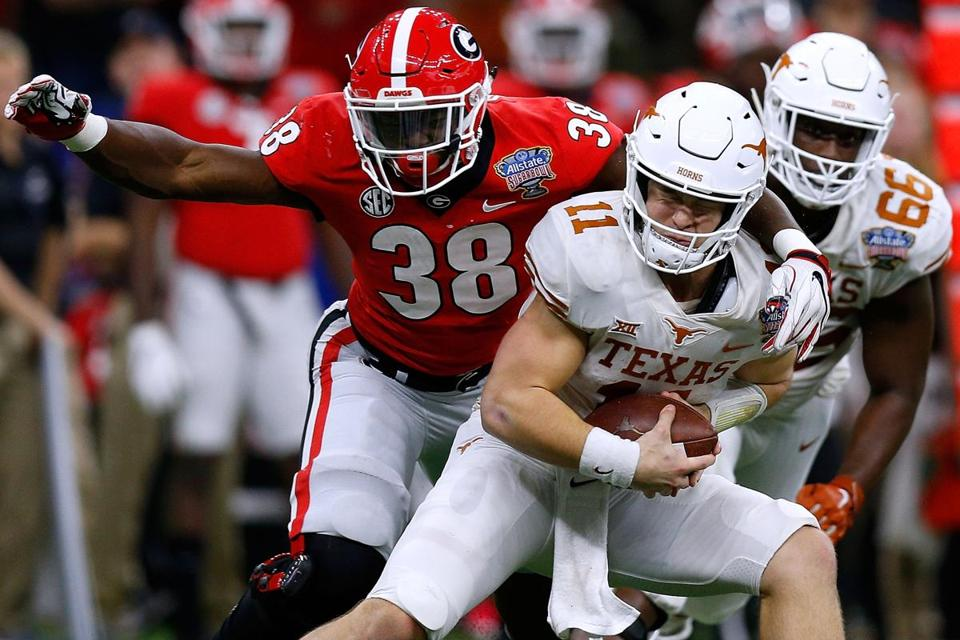 NEW ORLEANS, LOUISIANA - JANUARY 01: Sam Ehlinger #11 of the Texas Longhorns is pressured by Azeez Ojulari #38 of the Georgia Bulldogs during the first half of the Allstate Sugar Bowl at the Mercedes-Benz Superdome on January 01, 2019 in New Orleans, Louisiana. (Photo by Jonathan Bachman/Getty Images)