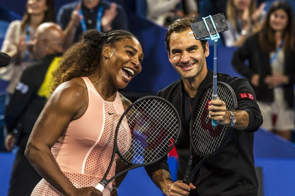 Serena Williams of the US (L) and Roger Federer of Switzerland (R) take a selfie after winning their mixed doubles match on day four of the Hopman Cup tennis tournament in Perth January 1, 2019. (Photo by TONY ASHBY / AFP) / -- IMAGE RESTRICTED TO EDITORIAL USE - STRICTLY NO COMMERCIAL USE --TONY ASHBY/AFP/Getty Images