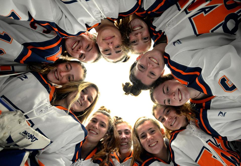 Walpole-01/05/19- Walpole High School's Hockey team has 6 sets of sisters. They stood in a circle before practice at mid-ice.(Clockwise from top starting at12 o'clock) Elizabeth Desimone, Emma McInerny, Meghan Hamilton, Jamie Ryan, Jess Tosone, Jenna Malone, Olivia Malone, Audra Tosone, Kiera McInerny, Emily Desimone, and Madison Ryan.Photo for the Boston Globe by Debee Tlumacki (sports)