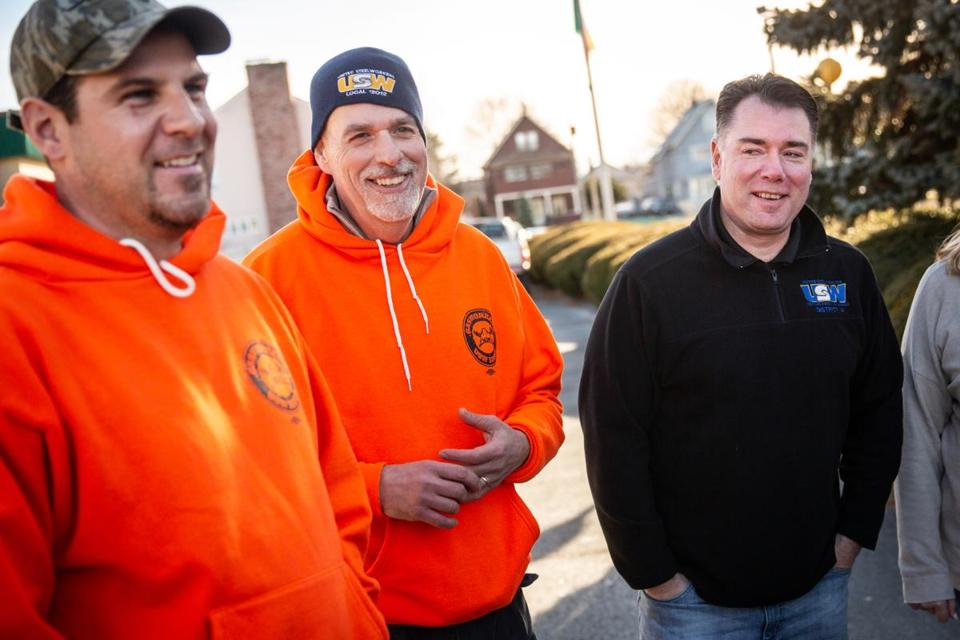 01/07/2019 MALDEN, MA 12012-4 union members L-R David Monahan (cq), Barry Johns (cq), and John Buonopane (cq) talk with fellow National Grid workers as they react to vote on new contract to end six-month lockout at the Irish American Club in Malden. (Aram Boghosian for The Boston Globe)