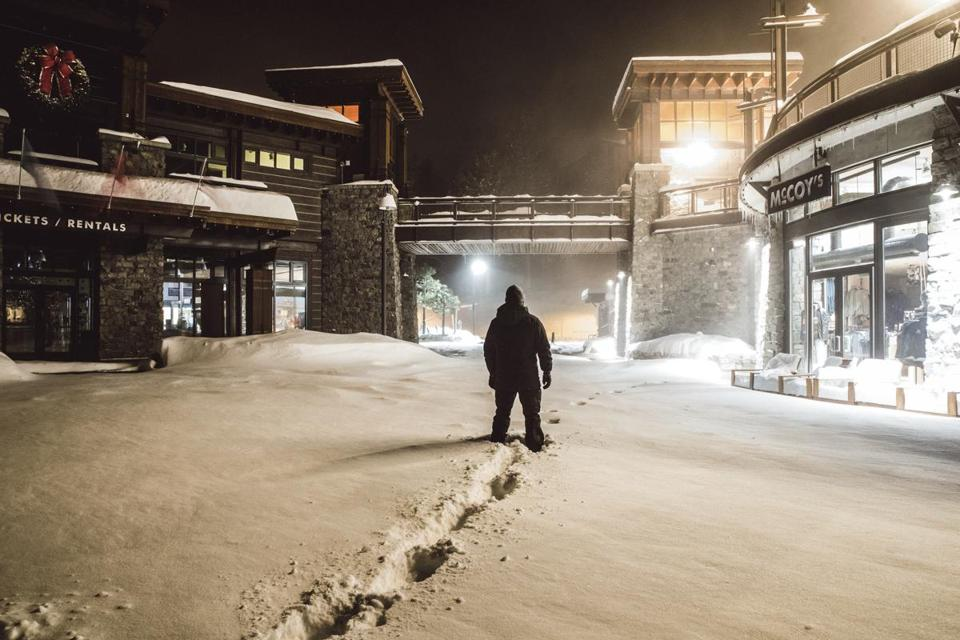 A visitor walked through fresh snow at Mammoth Mountain in Mammoth Lakes, Calif., which received 4.5 feet.