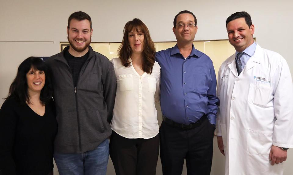 Melissa Cohen (left) flanks Christopher Cassidy, to whom she donated a kidney. Next to Cassidy is Erin Brunelle, who will donate a kidney so that Don Burl II, an extended family member, can move up the transplant list. At right is Dr. Nahel Elias, surgical director of renal transplants at MGH.