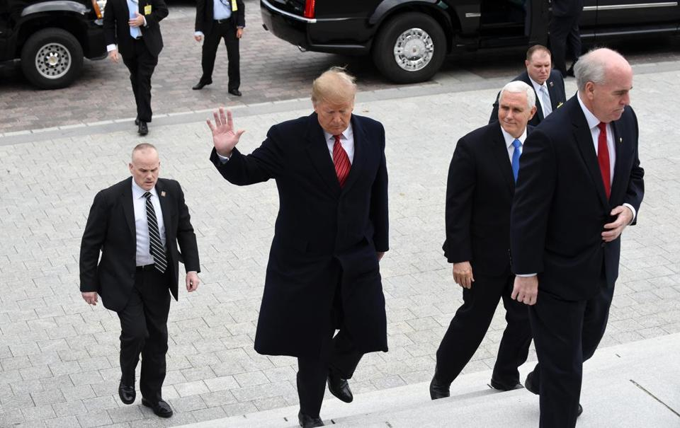 President Donald Trump (center) and Vice President Mike Pence (third from left) arrived at the US Capitol Wednesday.