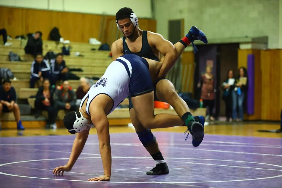 Shawsheen Tech's Omar Eldaly takes down Lawrence's Johnathan Vellila in the 220 weight class. Mark Lorenz for the Boston Globe.