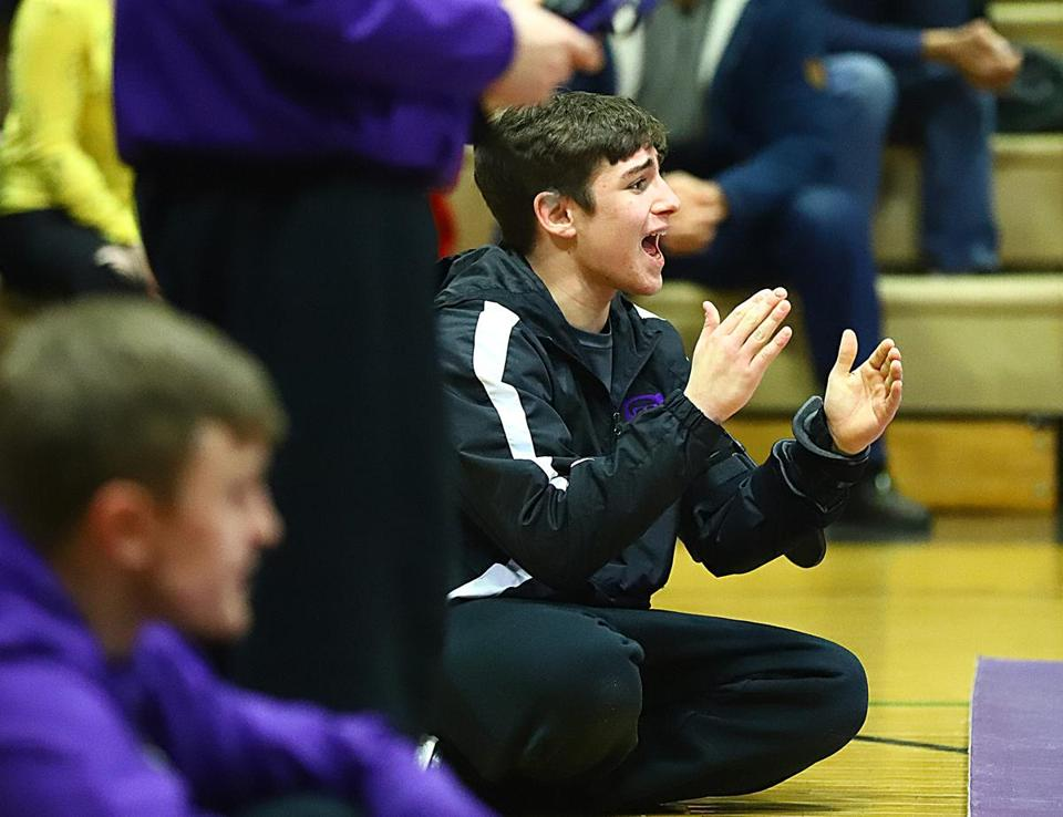 Vinny Foti cheers on his teammates during Shawsheen's dual match Wednesday against Lawrence.