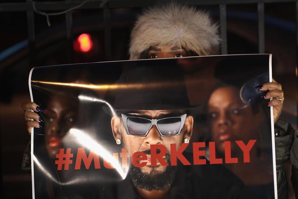 "CHICAGO, ILLINOIS - JANUARY 09: Demonstrators gather near the studio of singer R. Kelly to call for a boycott of his music after allegations of sexual abuse against young girls were raised on the highly-rated Lifetime mini-series ""Surviving R. Kelly"" on January 09, 2019 in Chicago, Illinois. Prosecutors in Illinois and Georgia have opened investigations into allegations made against the singer, whose real name is Robert Sylvester Kelly. (Photo by Scott Olson/Getty Images)"