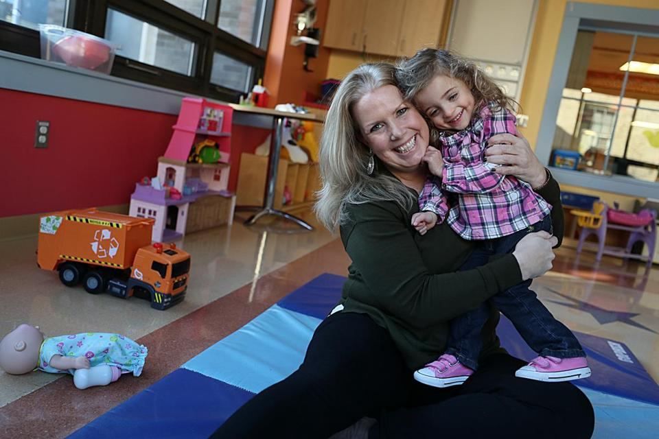 After a long adoption process, Liz Smith, 45, of Lowell, is now the mother of 2-year-old Gisele.