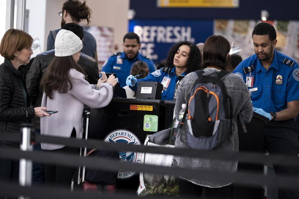 TSA agents worked in a security line at LaGuardia Airport in New York this week. Due to staffing shortages, some security checkpoints at airports will soon be shut down.