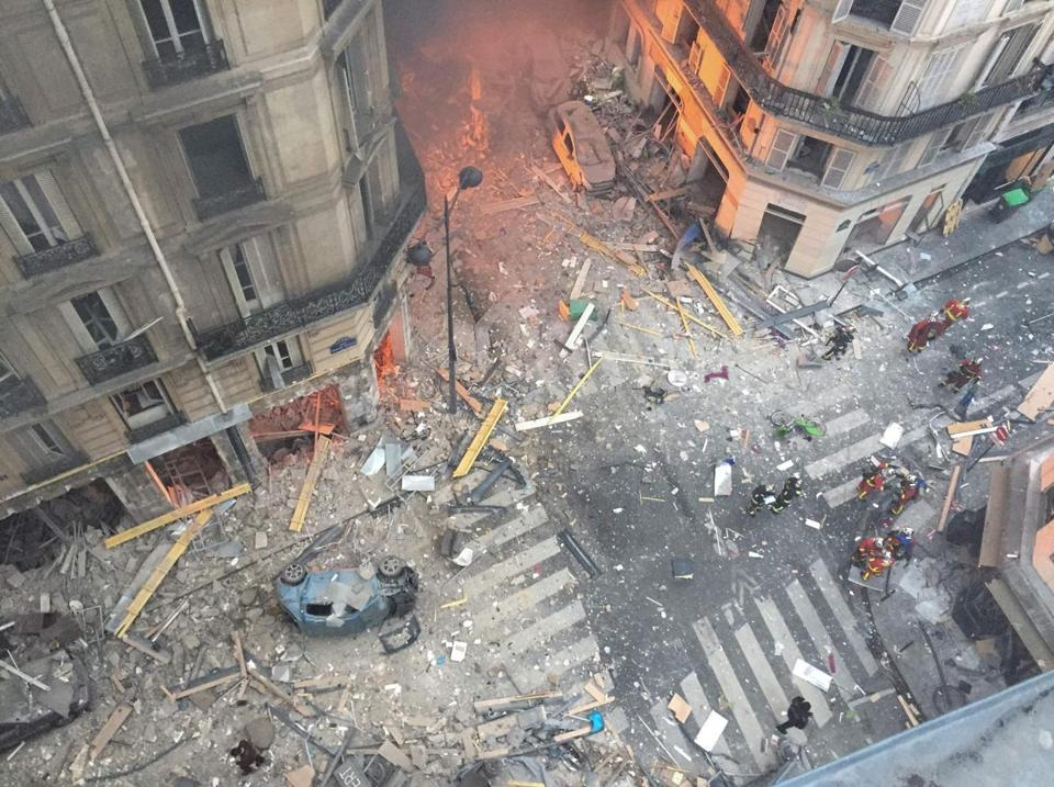 Debris and car wreckage covered the area following the explosion of a bakery in central Paris on Saturday.