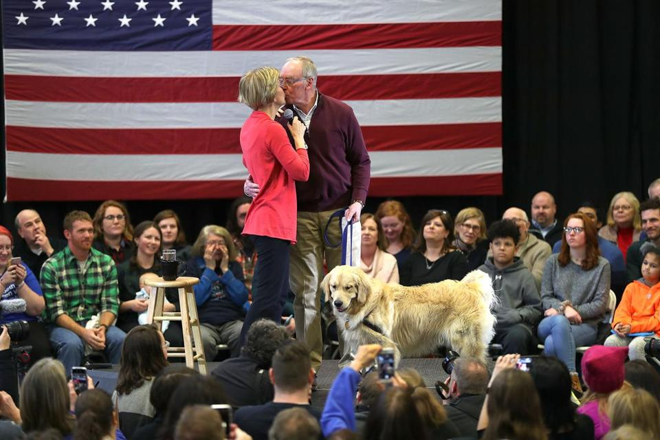 Manchester, N.H. -01/12/19 Senator Elizabeth Warren kisses her husband Bruce as he was introduced with their dog Bailey on stage as she made a stop at Manchester Community College where she spoke and greeted attendees. Photo by John Tlumacki/Globe Staff(metro)