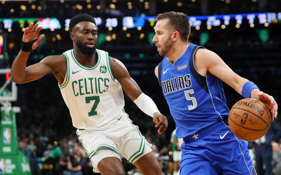 Mavericks guard J.J. Barea (5), facing the Celtics' Jaylen Brown last week, starred at Northeastern from 2002-06.