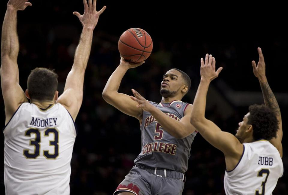 Boston College's Wynston Tabbs (5) goes up for a shot between Notre Dame's John Mooney (33) and Prentiss Hubb (3) during the first half of an NCAA college basketball game Saturday, Jan. 12, 2019, in South Bend, Ind. (AP Photo/Robert Franklin)