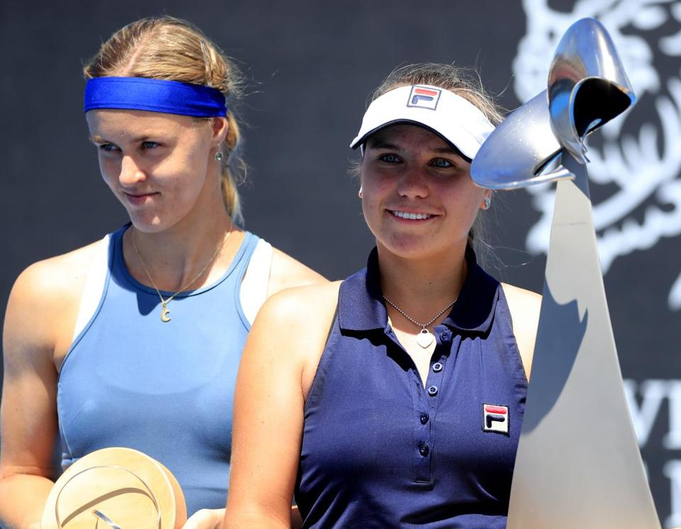 Sofia Kenin (right) poses with her first WTA singles title trophy after beating Anna Karolina Schmiedlova (left).