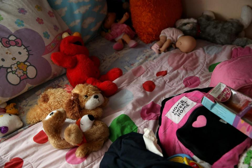 Stuffed animals lay on her daughter's bed at Cynthia's home. The DCF took her children into custody over a variety of concerns, some involving the children's father.