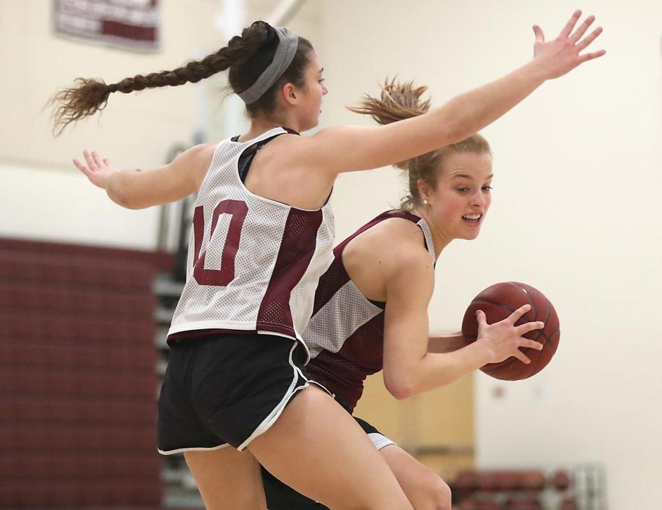 "Concord-Carlisle senior captain Hope Lefebvre (10) said of Barach (with ball): ""It's so fun to match up with her in practice, I think it's made me a better player."""