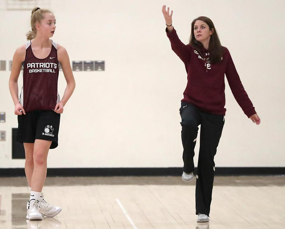 Concord-Carlisle girls' basketball coach Kim Magee works with freshman Rachel Barach, Kori's younger sister, during practice.