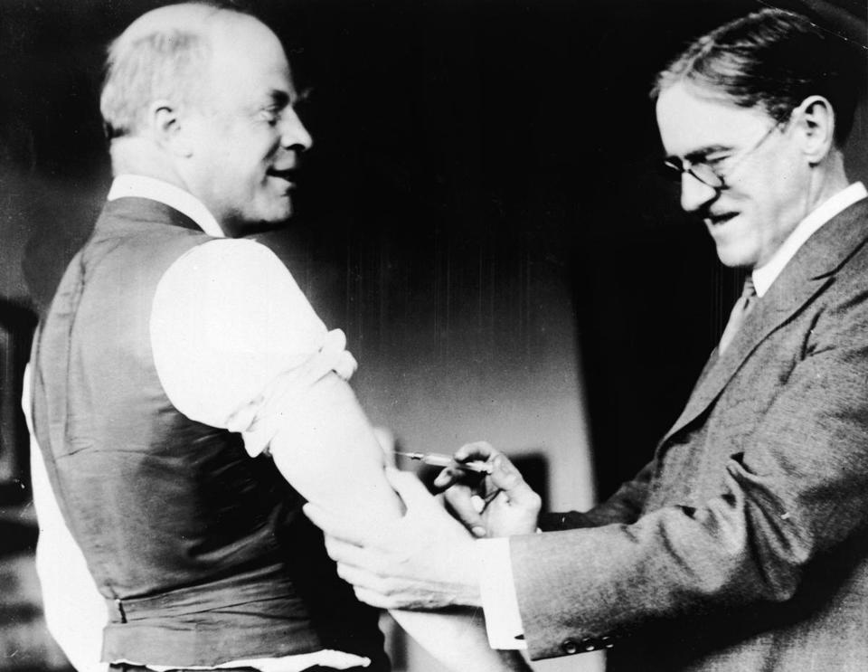 A doctor innoculates Major Peters of Boston against the Spanish Influenza virus during the epidemic, c. 1918. (Photo by Hulton Archive/Getty Images)