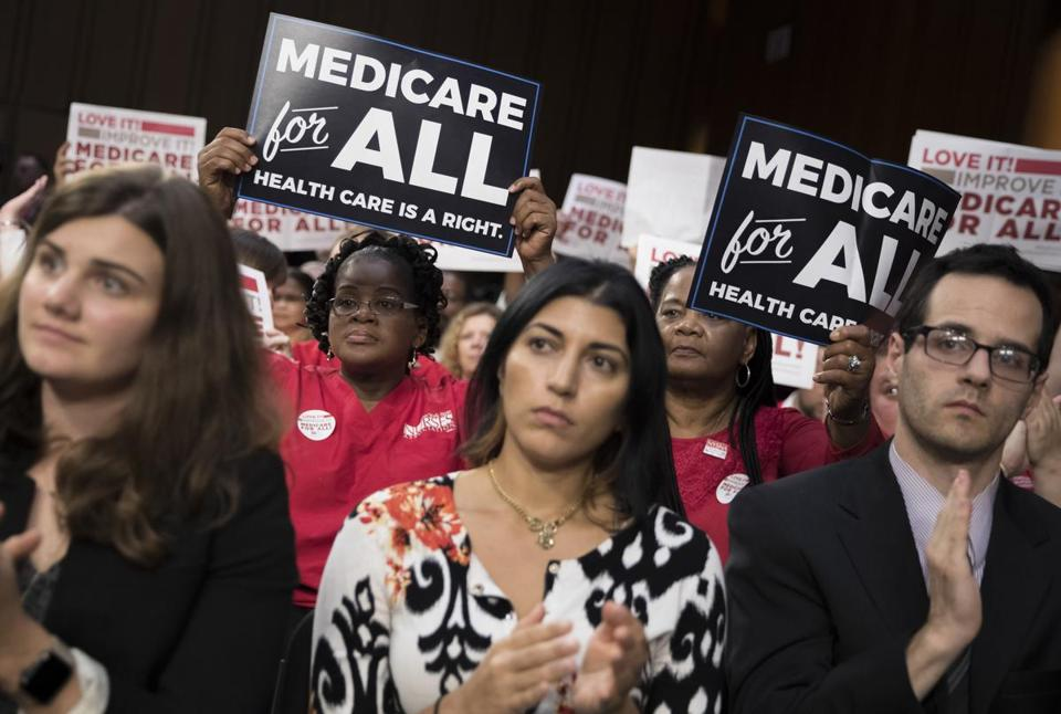 FILE — Members of National Nurses United at a speech by Sen. Bernie Sanders (I-Vt.) about health care on Capitol Hill in Washington, Sept. 13, 2017. A Medicare-for-all bill drafted by Sanders is gaining support among Democrats as they look ahead to the 2020 presidential race. (Tom Brenner/The New York Times)