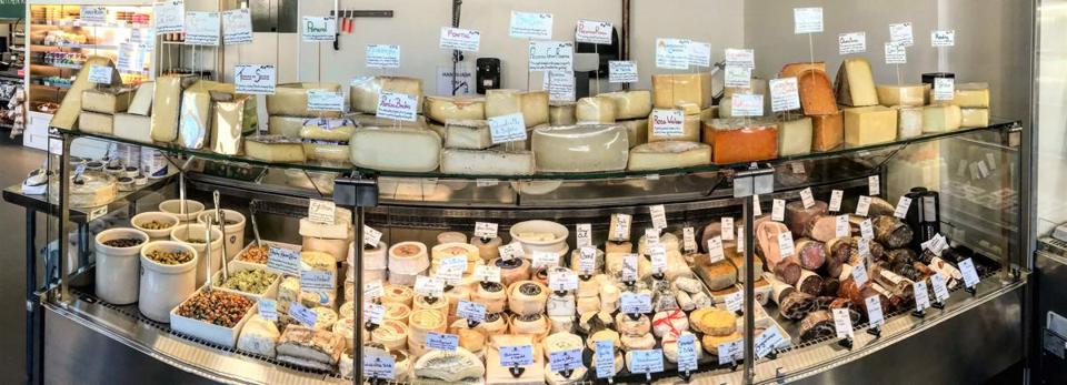 The cheese case at Formaggio Kitchen Kendall.